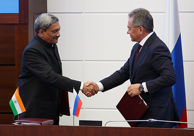 File pic - Sergei Shoigu and Manohar Parrikar shakes hand.