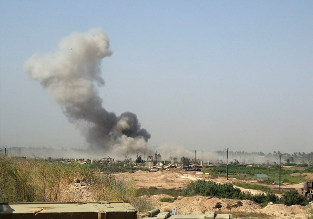 Smoke rises from ISIS positions after an airstrike by