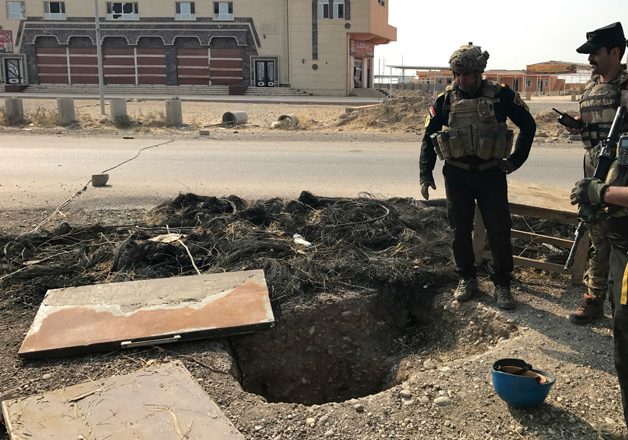 Iraq's elite counterterrorism force inspects a tunnel made