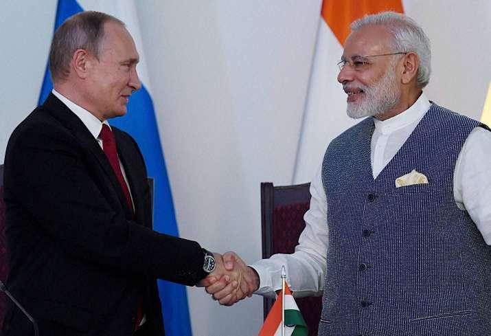 PM Narendra Modi and Vladimir Putin at the agreement