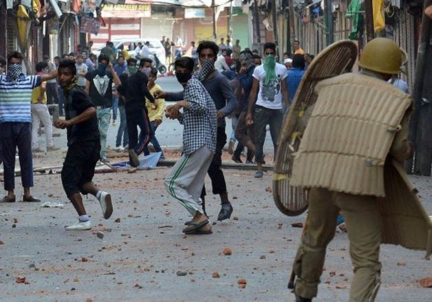 File pic - A jawan saves himself from protesting youths