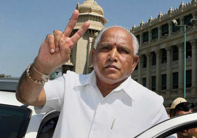 File pic - BS Yeddyurappa flashes victory sign outside