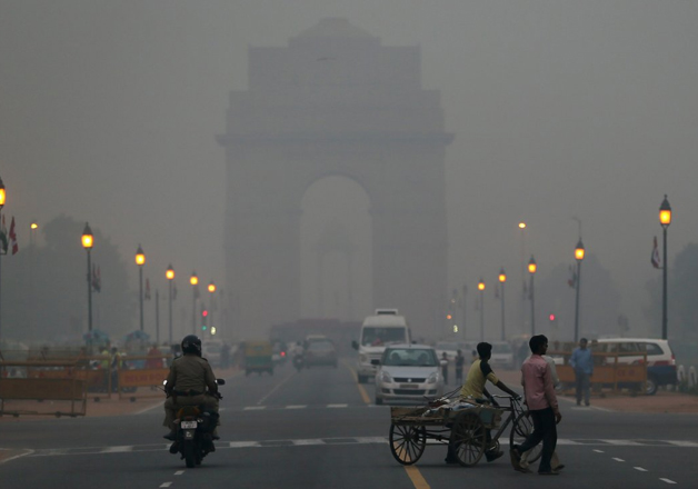 File pic - A view of India Gate covered by thick layer of