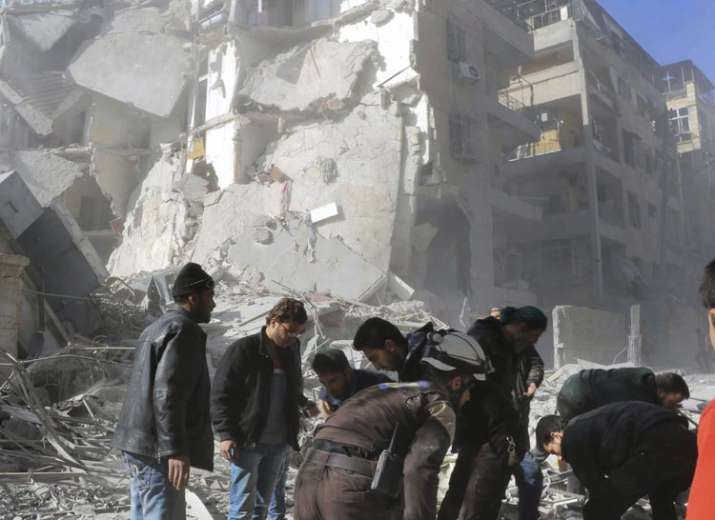Damaged building after airstrikes in Aleppo, Nov 19