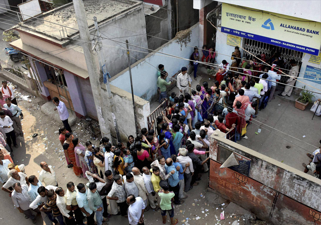 People queue up outside an ATM in Patna