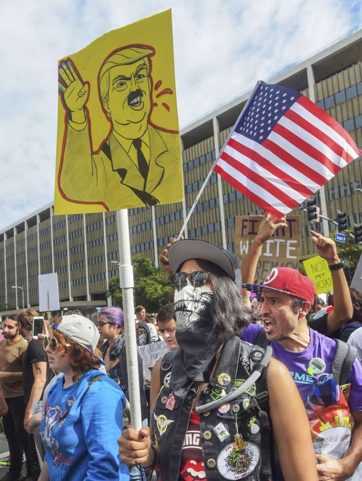 India Tv - People participated in an anti-Trump protest in downtown Los Angeles, Saturday