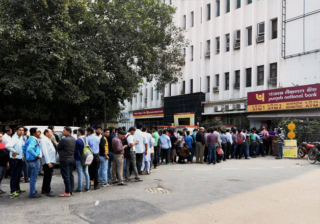 People queue up outside at ATM to withdraw money in New