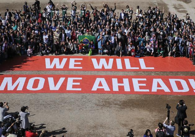 COP22 participants stage a public show of support for Paris