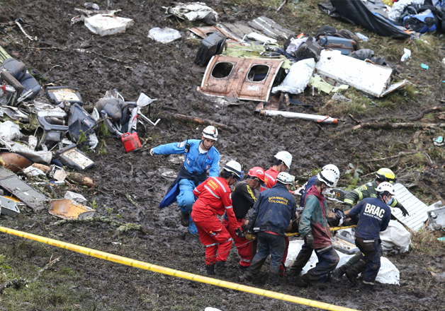 Rescue workers at the site of an airplane crash in La Union