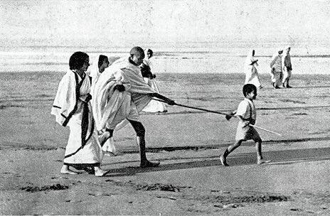India Tv - Kanu Gandhi walking ahead of Mahatma Gandhi on Dandi March