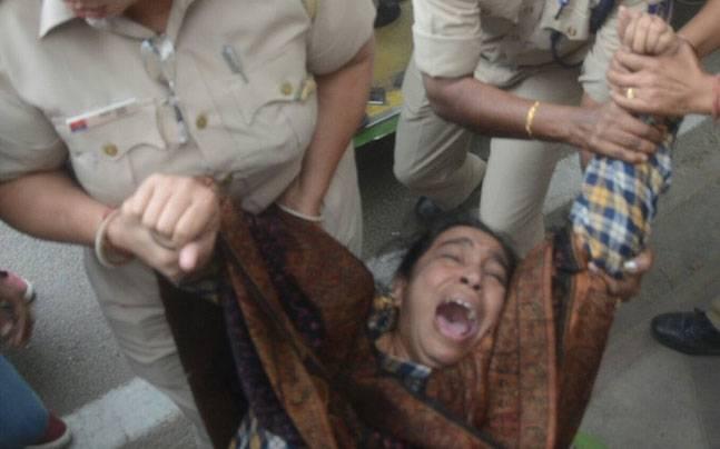 Delhi Police detain missing JNU student's mother.