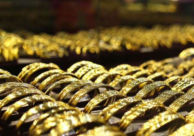 File pic - Gold bangles put on display at a jewellery shop