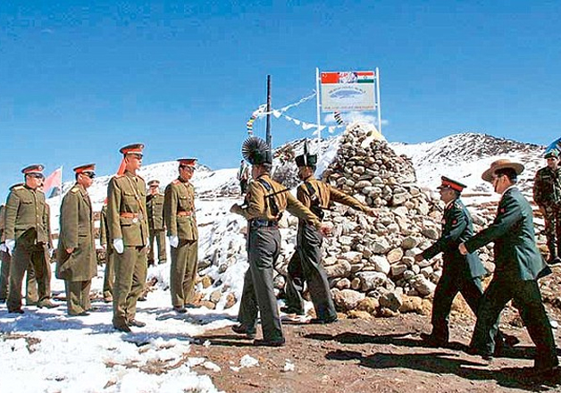 File photo - Indian and Chinese soldiers meet at the