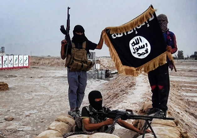 File pic - ISIS militants wave terror group's flag in Iraq