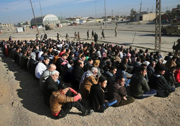 Scores of Iraqi male residents rounded up by the Iraqi army