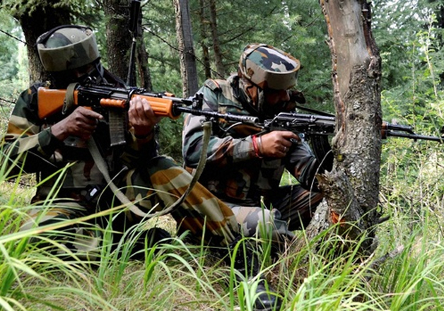 File pic - Indian jawans takes position near an Army base