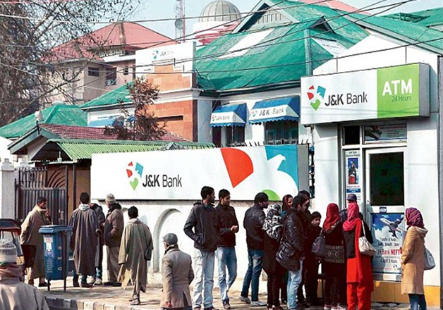 People stand in queue outside J&K bank ATM in Kashmir to