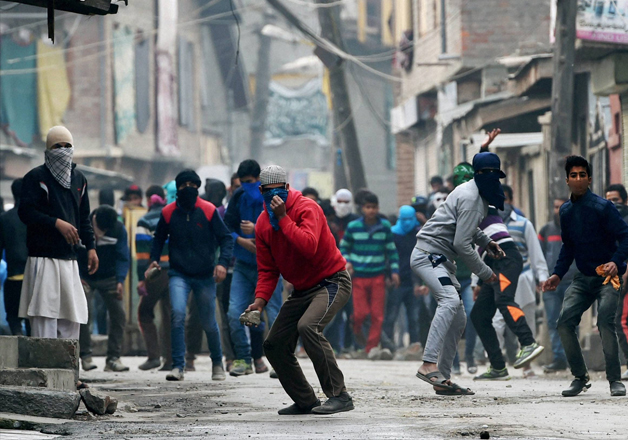 Youths pelting stones at security forces in Srinagar