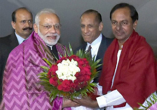 PM Modi being received by Chandrashekhar Rao on his arrival