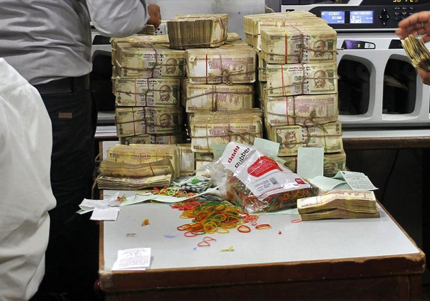 Officials count seized Rs 3.5 crore demonetised notes at