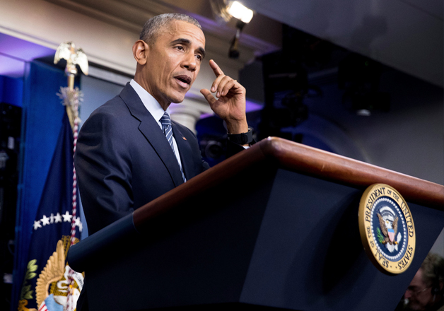 Barack Obama speaks during a news conference at the White