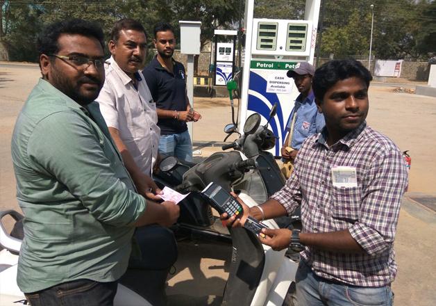 Cash dispensation at HP petrol pump in Mysore