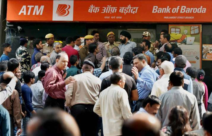 People scuffle to exchange Rs 500 and Rs 1000 notes at a