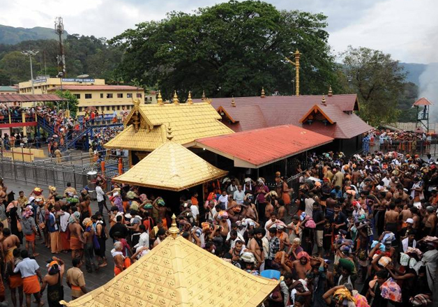 File pic - Devotees gather at Sabarimala temple to offer