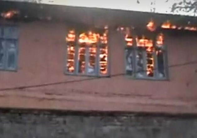 File pic - A school building set ablaze in Kashmir
