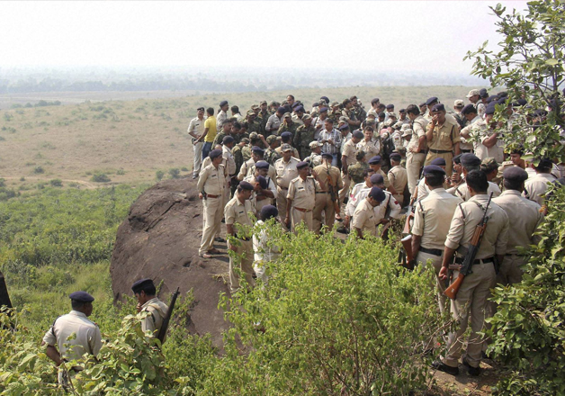 Police personnel at the encounter site at the hillocks of