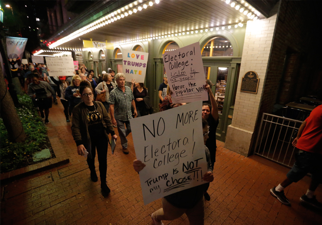 Protesters march in opposition of Donald Trump's win in