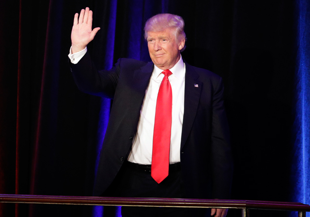 Donald Trump waves hand to his supporters at victory rally