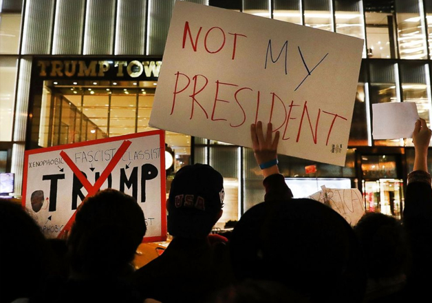 Dozens of anti-Donald Trump protesters outside Trump Tower.