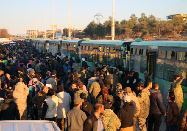 Residents gathered near govt buses for evacuation from