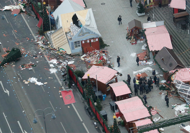 Officials visit the site of the attack in Berlin