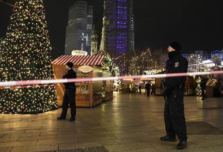India Tv - Police guard a Christmas market in Berlin