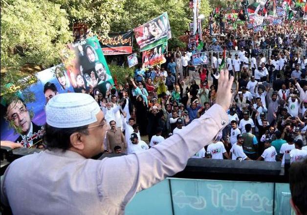 Zardari waves to supporters who gathered near Karachi