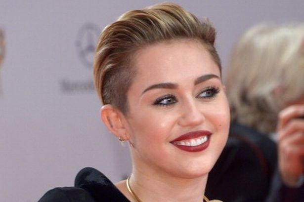 Miley Cyruss Music Video Out See Pics  Masala News  India Tv-1248