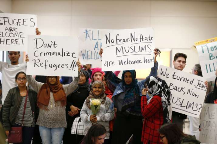 India Tv - Protesters demonstrate against Trump's travel ban at Dallas Forth Worth Airport
