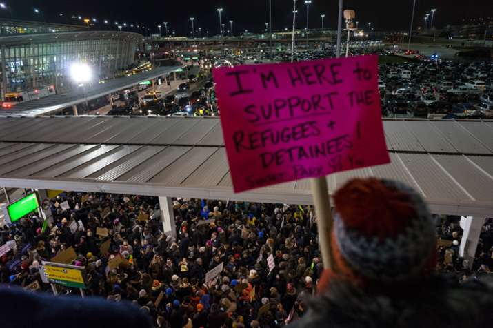 India Tv - Protesters assemble at John F. Kennedy International Airport in New York