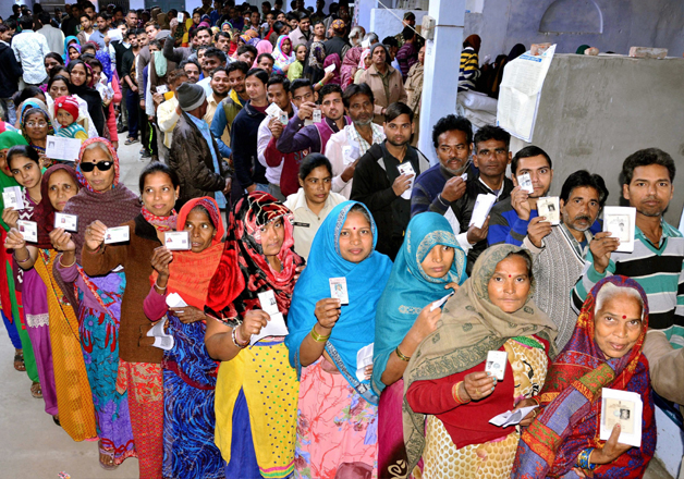 People stand in queue to cast their vote in Agra