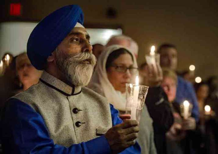 India Tv - People in prayer vigil for Indian engineer, killed in a bar shooting incident
