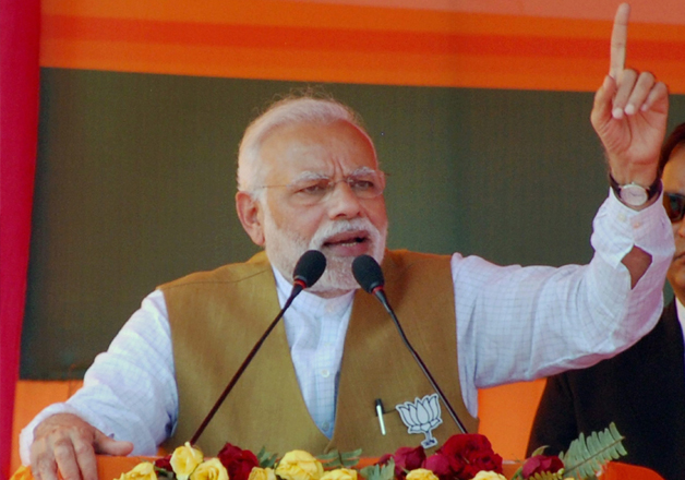 Narendra Modi addresses at an election rally in Fatehpur,
