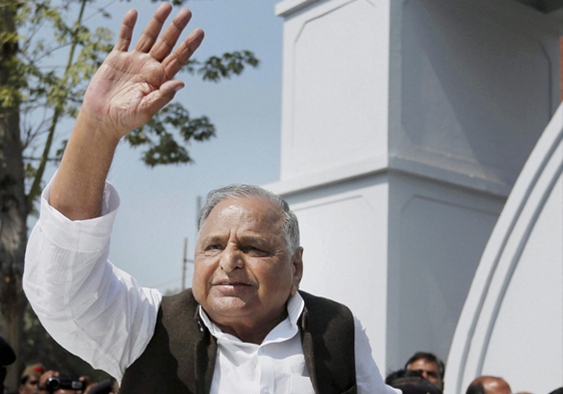 Mulayam Singh Yadav waves to supporters after casting his