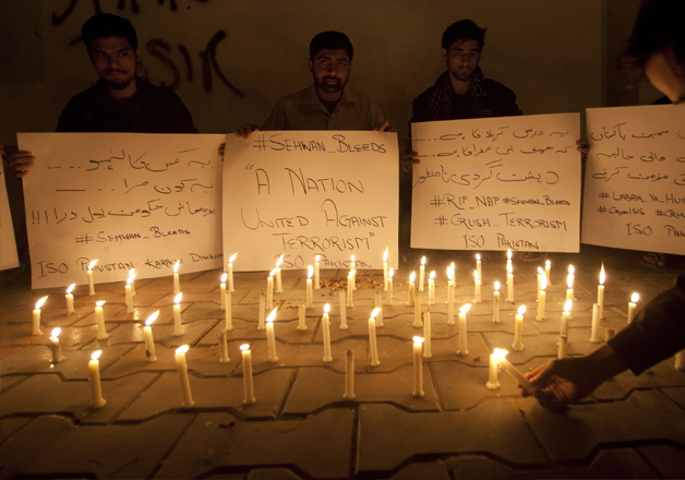 People take part in candle march after terror attack in