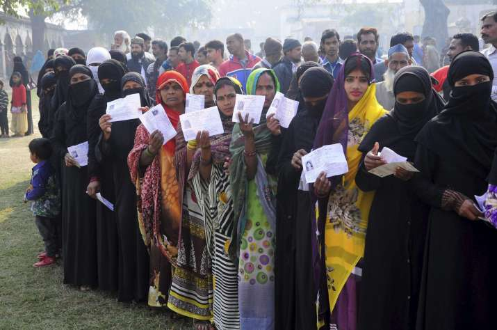 Voters in Lakhimpur Kheri queue up to cast vote at a