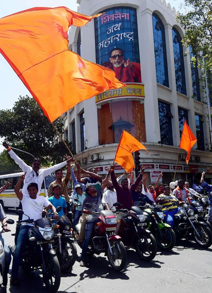 India Tv - Shiv Sena activists celebrate over the results of BMC Election results