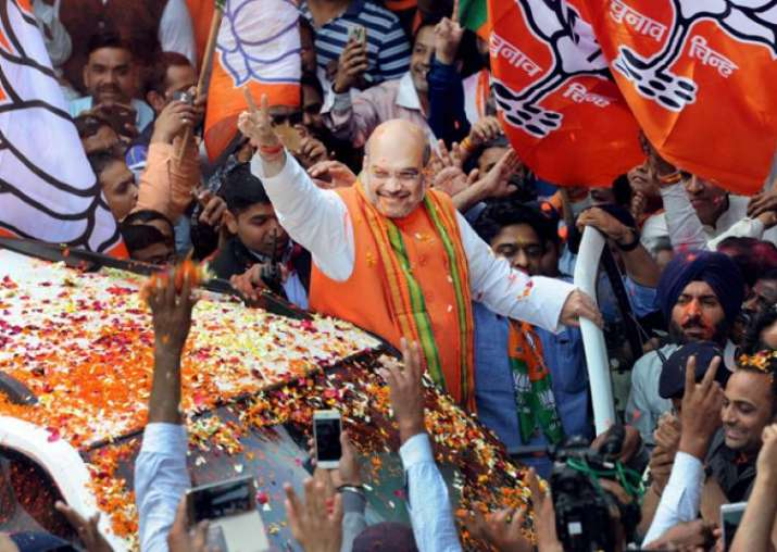 India Tv - BJP President Amit Shah waves at party workers in Delhi