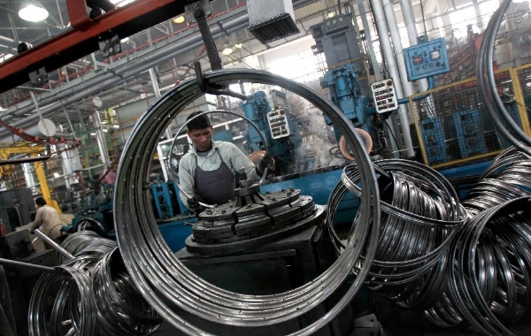 A worker at a manufacturing factory for cycle parts in