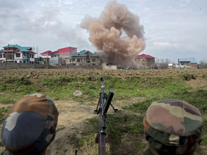 Budgam Smoke blowing out after forces blasted a house to